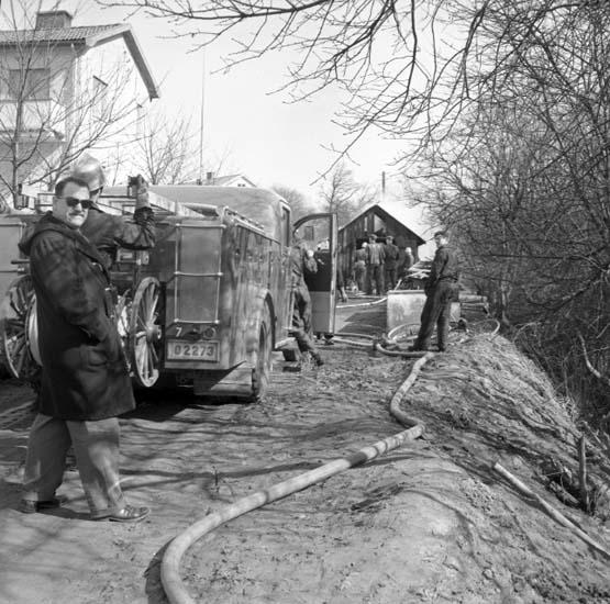 "Enligt notering: ""Brand Östra Gröngatan april -58""."