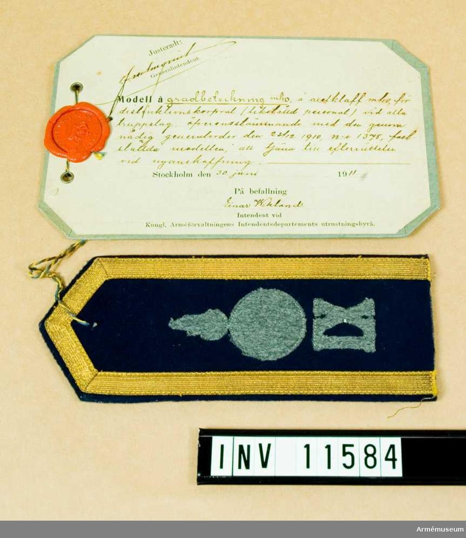 Grupp C I.  Gradbeteckning m/1910 å axelklaff m/1910 för distinktionskorpral vid alla truppslag.