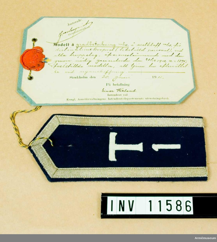 Grupp C I.  Gradbeteckning m/1910 å axelklaff m/1910 för distinktionskorpral.