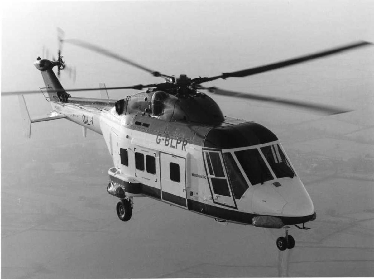 Ett helikopter i luften. Westland 30-160, G-BLPR (OIL 1)