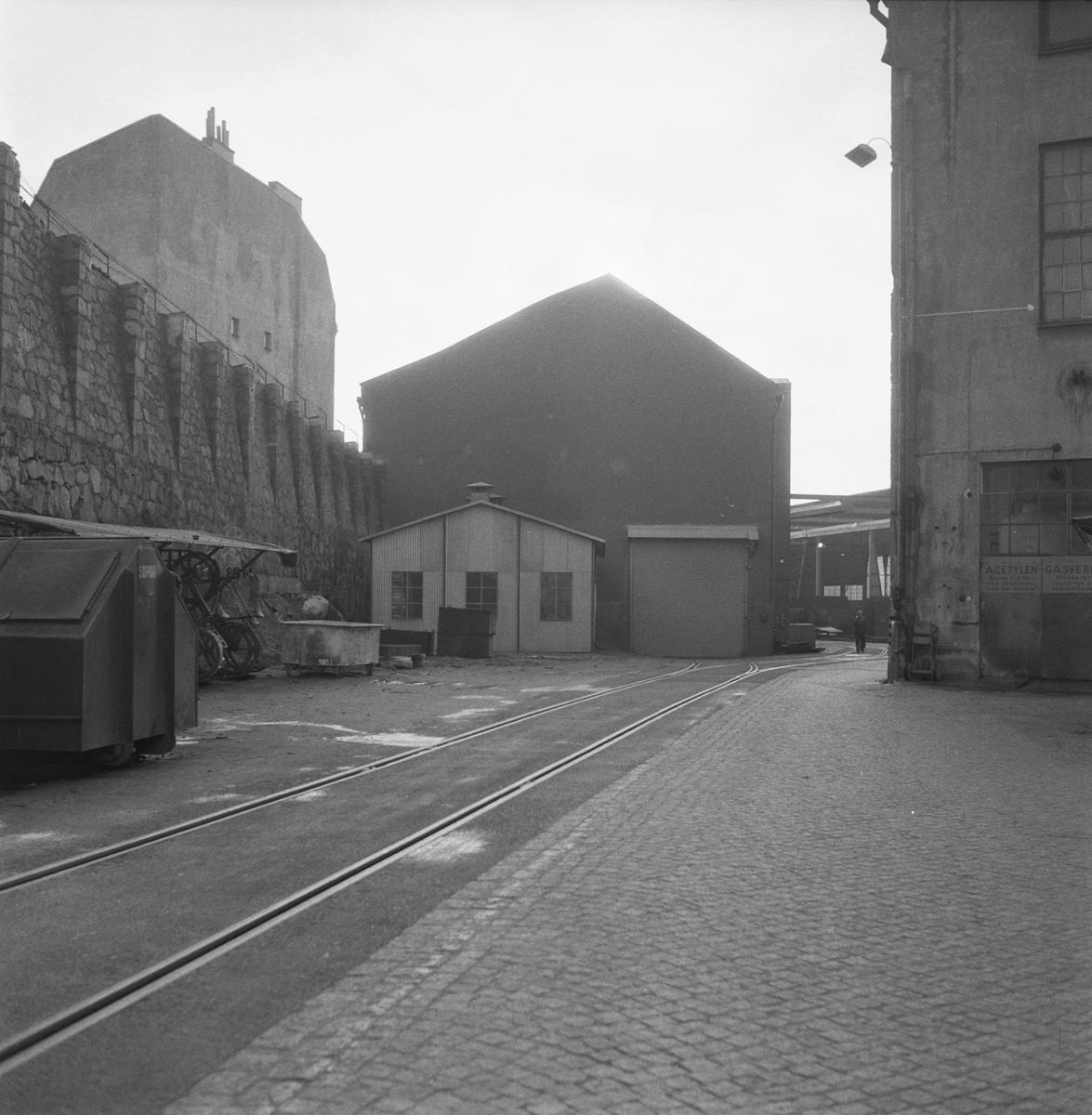 Övrigt: Fotodatum:5/1 1959 Byggnader och Kranar. Järnförrådet exteriör. Närmast identisk bild: V16312, ej skannad