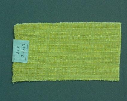 Möbeltygsprov i gult vävt i fantasibindning enligt tidigare inventering, med bomullsgarn i varp och lin- och ullgarn i inslag. Ytterligare prov med vissa vävuppgifter finns i pärmarna Möbeltyg a och Möbeltyg e, litt c 248.
