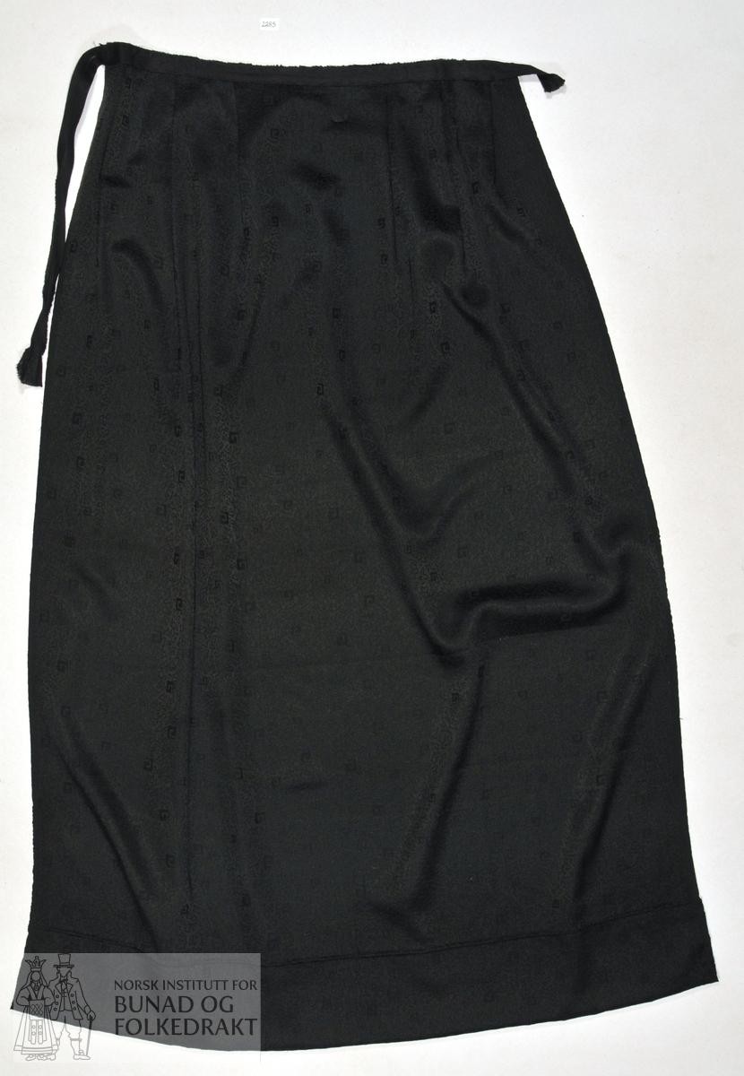 Forkle av jaquardvove svart silke.