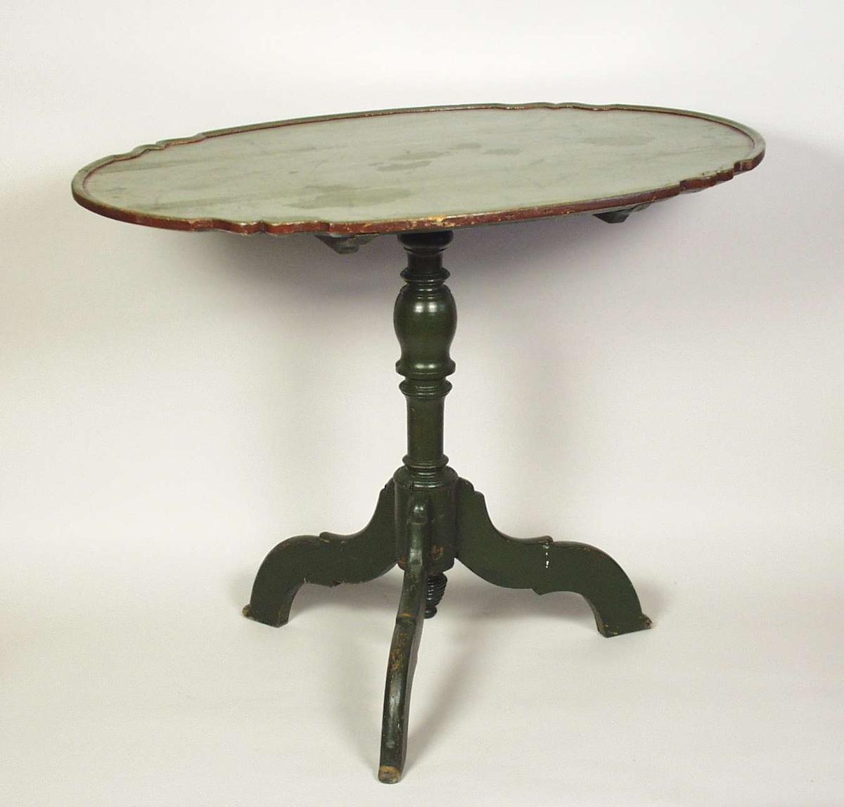Vippebord med oval bordplate og tredelt fot. Foten er dreid. Bordet er grønnmalt. Bordplaten er ådret.
