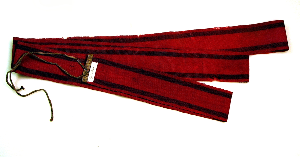 Barnelist-reiveband.  Mottatt:O. Skavhaugen, Skavhaugen, Elverum.  Knytteband i en ende.  Vevet på grind eller bandvevstol.