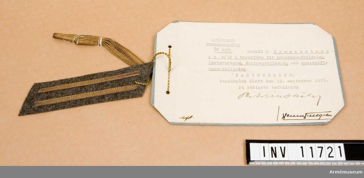 Grupp C I.  Examenstecken m/1939 i bronsfärg för korpralsutbildning (motsvarande) furirsutbildning och underofficersutbildning. Fastställt 1939 09 22.