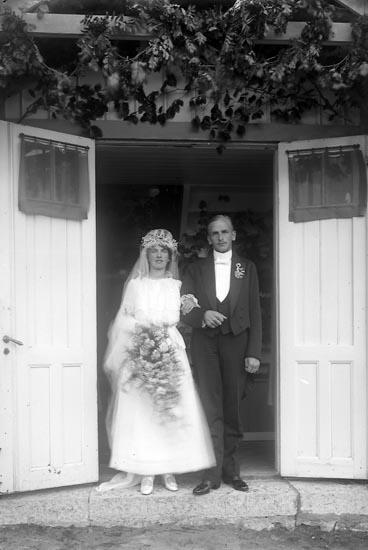 """Enligt fotografens journal nr 3 1916-1917: """"Wassén, Gustaf, Handl. Färgelanda""""."""