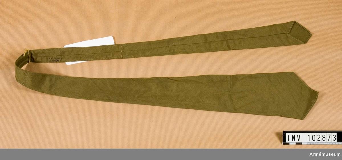 "Grupp C I. Av khaki, grönfärgat m stämpel ""E. J. Gefle, Glasgow"" (fabriksmärke)."