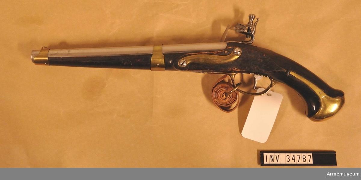 Grupp E III. Stämpel på kammarstycket med bokstäverna I B. Beslag av mässing. På kolvens vänstra sida ovanför sidblecket är numret 13 inslaget.  Samhörande nr: 34787-90, pistol, laddstock m rem, krats.