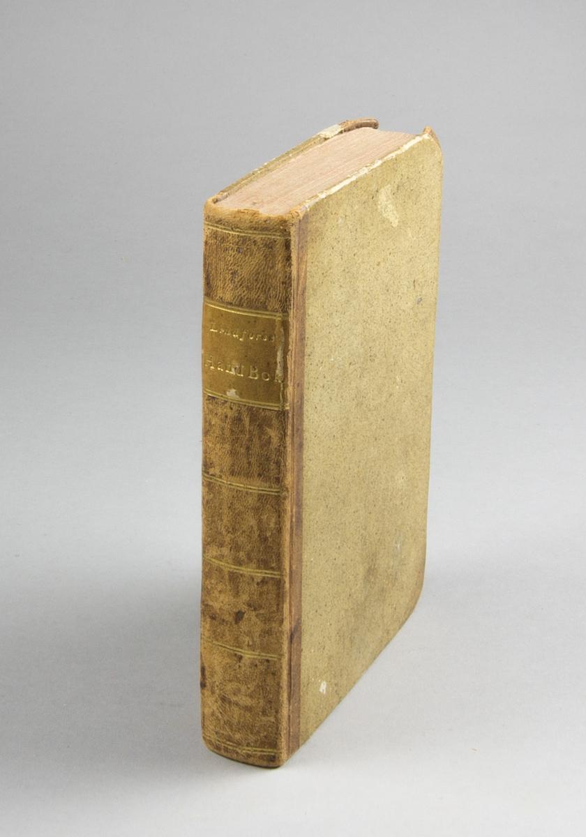 """Bok, halvfranskt band: """"Handbok i romerska antiqviteterna"""" skriven och utgiven av And. Otto Lindfors och tryckt hos Berlingska boktryckeriet i Lund 1814.  Bandet med sparsamt blindpressad och guldornerad rygg samt rödstänkta snitt. Pärmen klädd i marmorerat papper. Försättsbladet med handskriven namnteckning i bläck: """"O. W. Groth(?), 1880""""."""