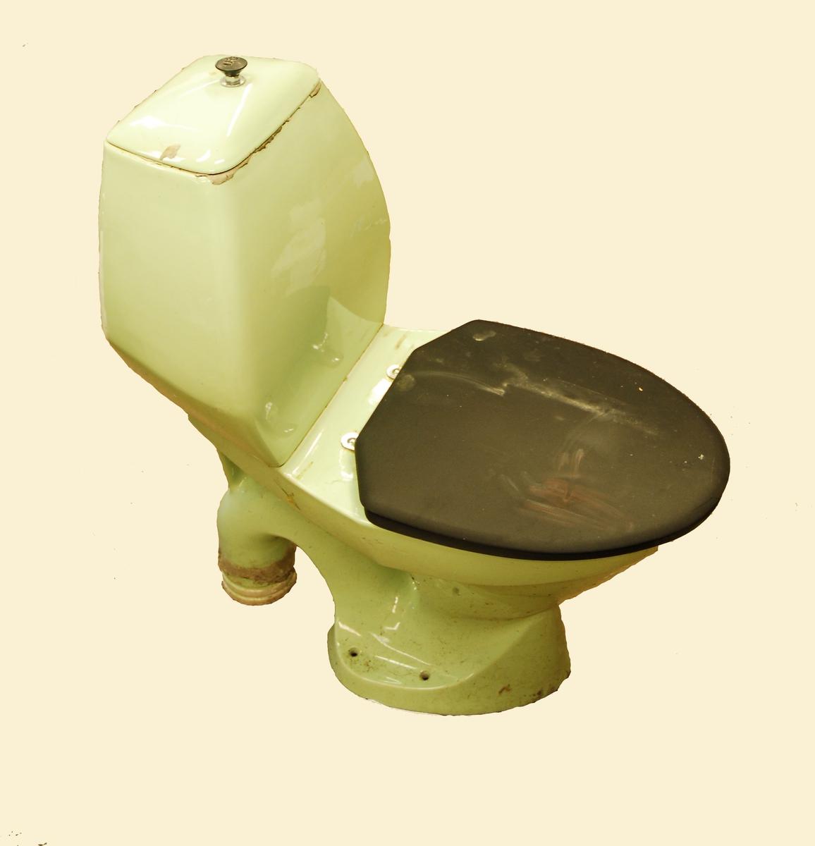 Lys grønt toalett - svart lok/kant