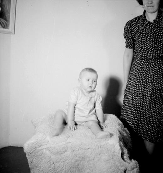 En kvinna och en liten flicka.Fru Maggie Fritz