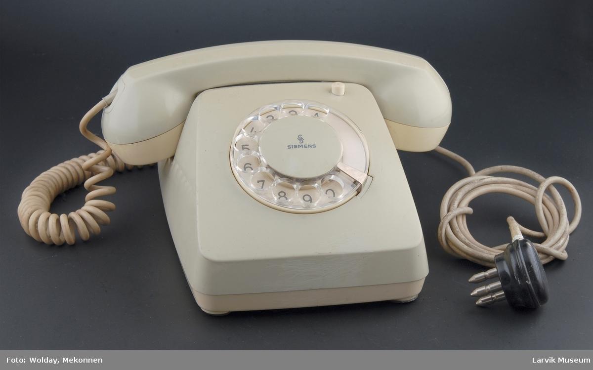 Form: Vanlig telefontype, tallskive  klar plast  Automat med jordknapp