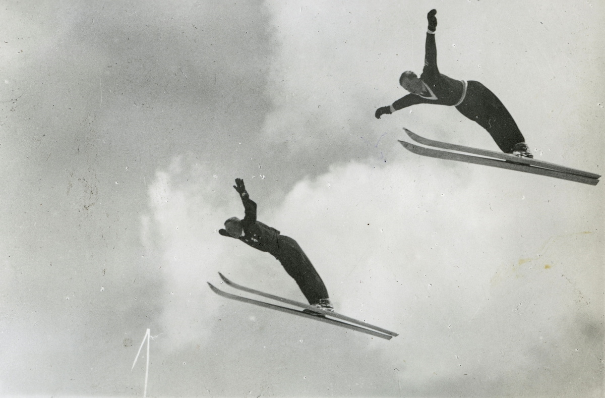 Norwegian skiers performing a double jump at Gramisch