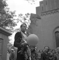 Studenterna tredje dagen, 1950.En student håller det sedvan