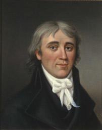 Portrett av Hans H. Nysom. Mørk drakt, hvit skjorte og halsbind. (Foto/Photo)