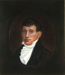 Portrett av eidsvollsmann Christopher F. Omsen.  Mann med kort, mørkt hår, mørk kledning og hvit skjorte med hvitt halsbind, kalvekryss  Innskrevet i oval. (Foto/Photo)