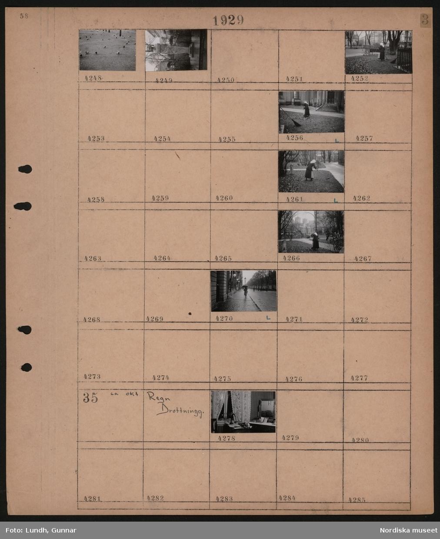 Motiv: Natt, Strandvägen; Stadsvy, kvinna räfsar löv, staty, fåglar, fotgängare.  Motiv: Regn, Drottninggatan; Interiör rum med skrivbord.
