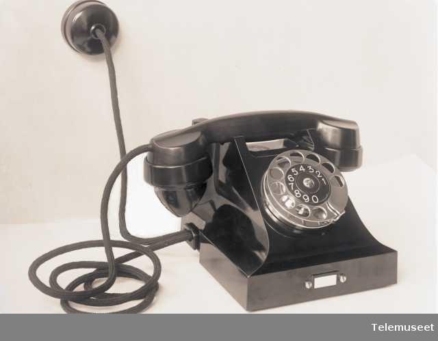 Telefon, automat, bordapparat i bakelitt, med mtlf.liggende, klokke 1000 ohm, 1932-modell, Elektrisk Bureau.