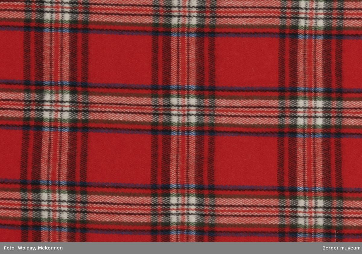 Knepledd. Vognpledd. Skotskrutet. Striper som møtes i rutemønster. Stripene har ulike bredder og farger.