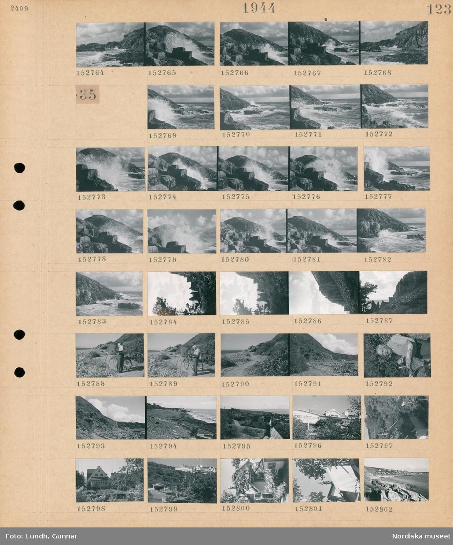 Motiv: (ingen anteckning) ; Landskapsvy med klippor och hav.  Motiv: (ingen anteckning) ; Landskapsvy med klippor och hav, en man målar vid ett staffli på en strand, porträtt av en man med palett, vy över bebyggelse och hav.