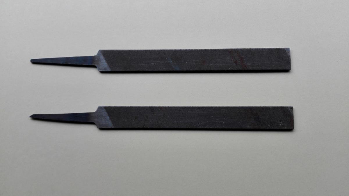 To små finmønstra flatfil utan påsett skaft.