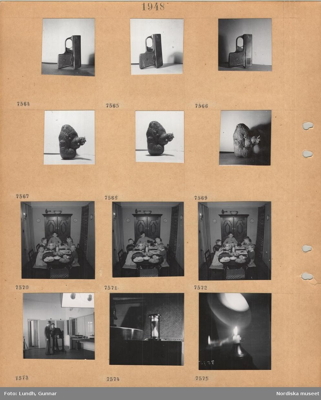 Motiv: Pistolattrapp, potatis med groddar, fem barn sitter och äter vid matbord, skåp, draperi, två män i fotoateljé, timglas, ljusstake med brinnande ljus.