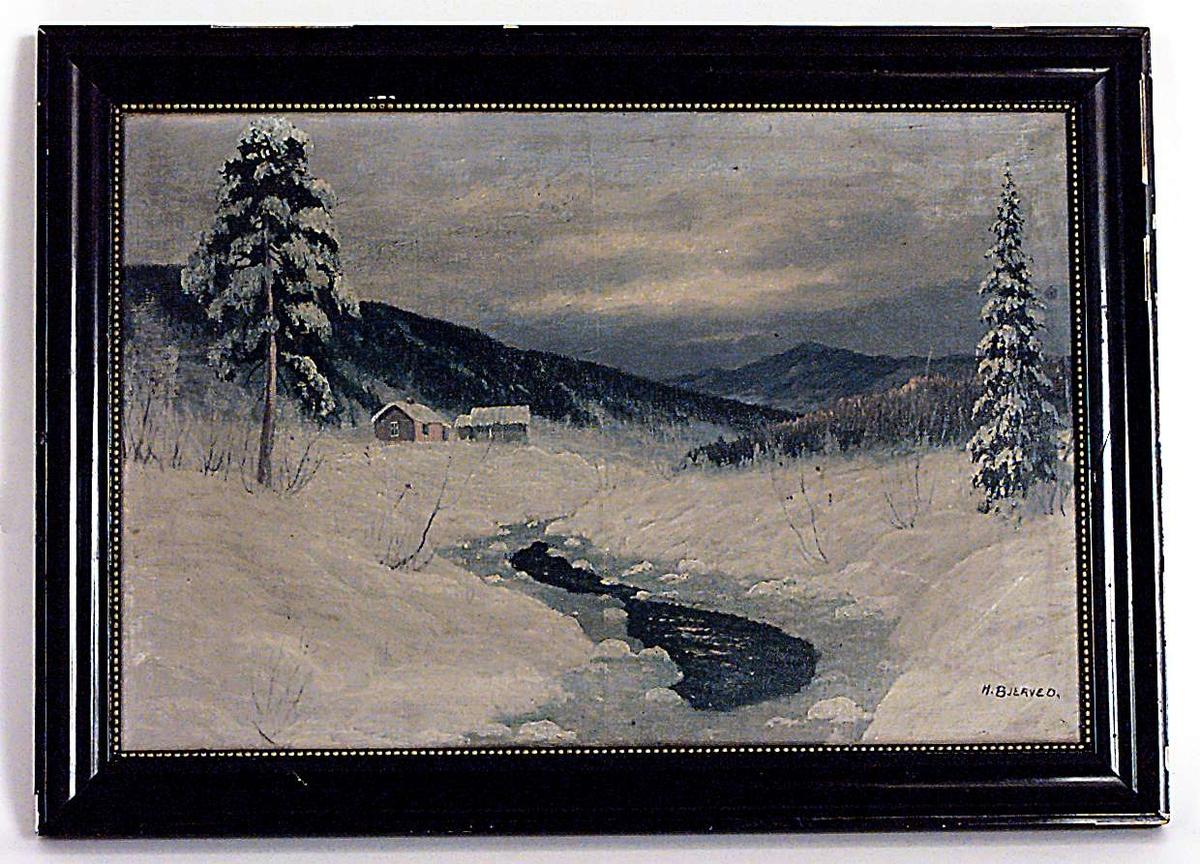 Vinterlandskap med hus, åser og trær