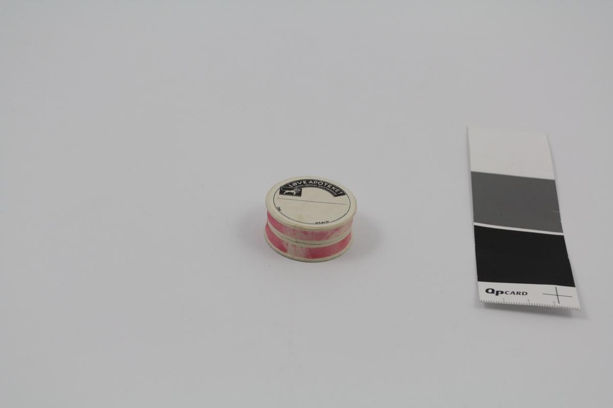 Rund pilleeske med lokk. Brukt til piller og dosert pulver på apotek.
