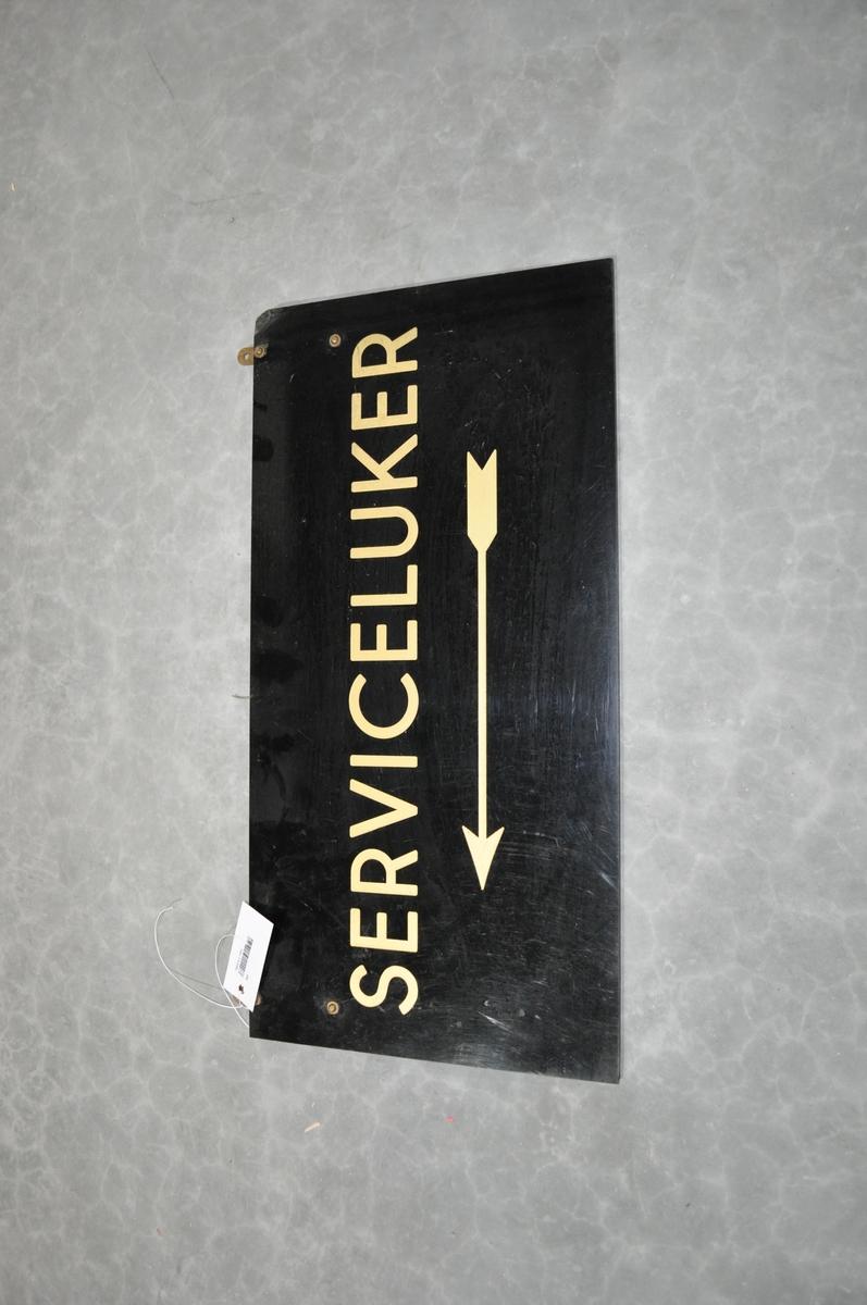 Henvisningsskilt til serviceluke på postkontor.