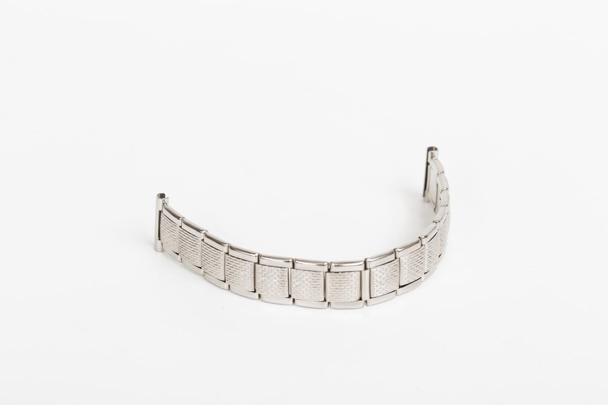 Enkel stållenke med ring i en ende.