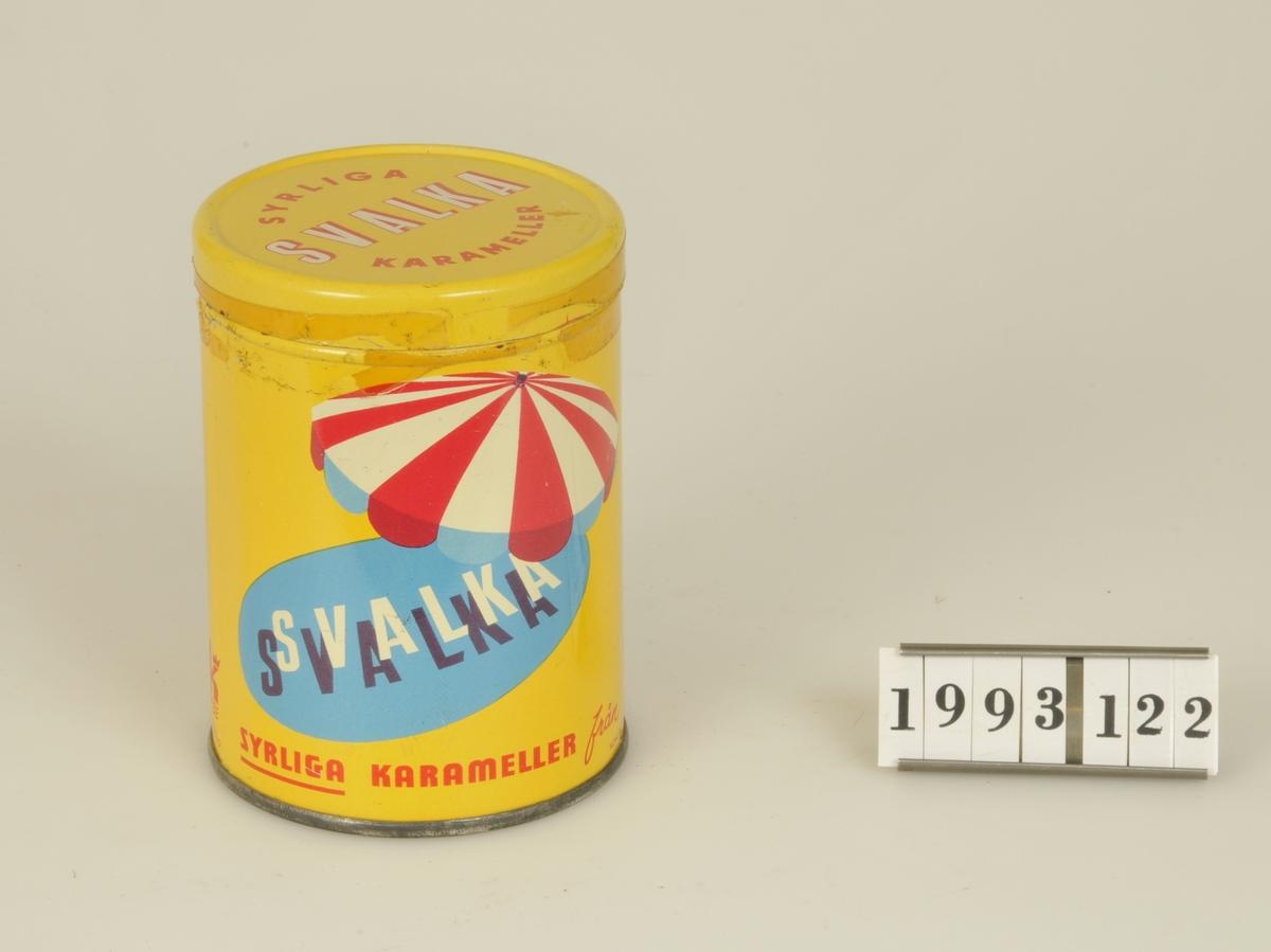 Syrliga karameller från LK, AB Lidköpings Konfektyr Industri Alingsås. Gullackerad  m text som ovan.