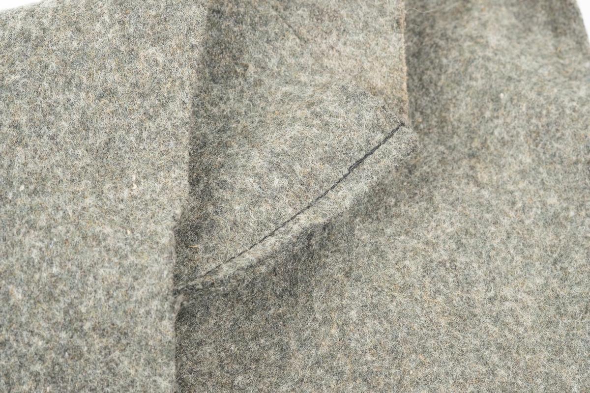 Det grågrønne trekket er trolig av ull og er formet som ukulelen.