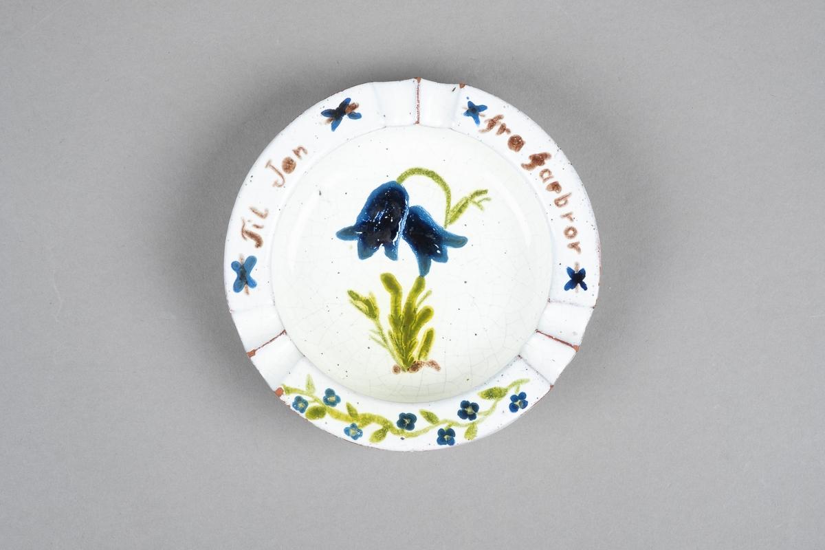 Motiv av en blåklokke med to blomster.