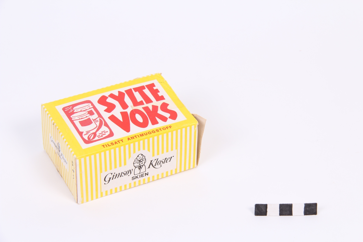 Ein gul kartong med Syltevoks