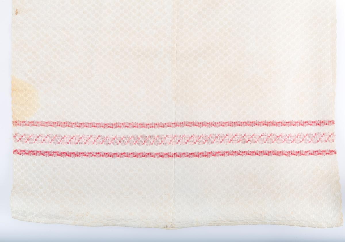 Håndvevet, lin og bomull. Rutemønster i veving. Røde triper i hver ende