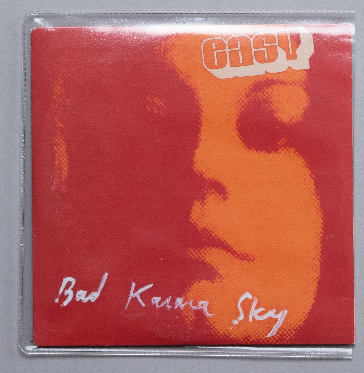 CD-skiva i konvolut av papper, i plastficka.  Innehåll: 1. Bad Karma Sky 2. Opend Mind  JM 55271:1, Skiva JM 55271:2, Plastficka JM 55271:3, Konvolut