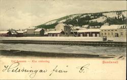 Vykort med motiv över hamnen en klar vinterdag i Sundsvall.