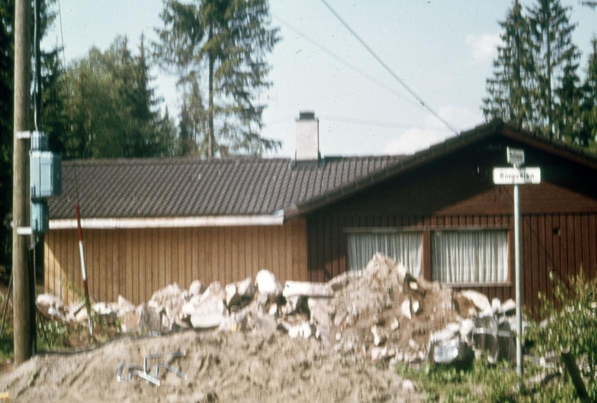 Stolpe + hus, Ringveien