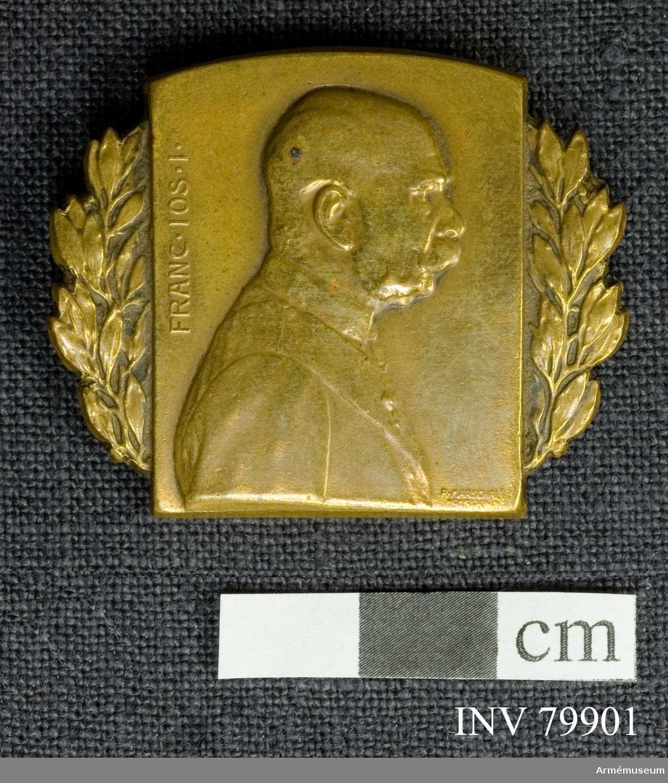 Grupp: M II. Märke med bild av Kejsar Frans Josef av Österrike.