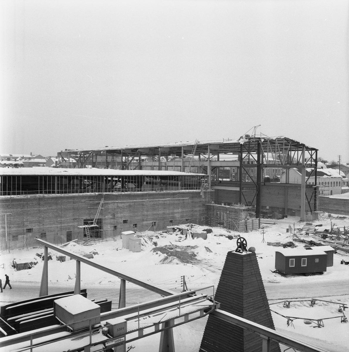 Övrigt: Fotodatum:8/2 1963. Byggnader och Kranar. Nyb. området nya plåtverkstan