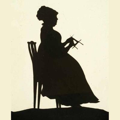 Silhuett. Kvinne som strikker. Foto/Photo