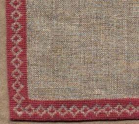 Duk broderad i korsstygn med rött bomullsgarn på  oblekt linne
