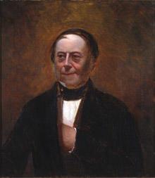 Portrett av Peter Schmidt. Mørk drakt, rødbrun vest, svart halsbind. Rødbrun bakgrunn. (Foto/Photo)