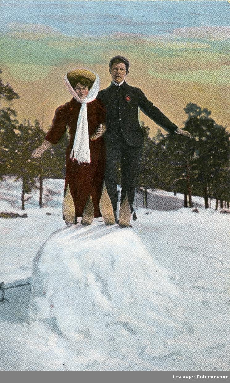 Postkort, par på ski.