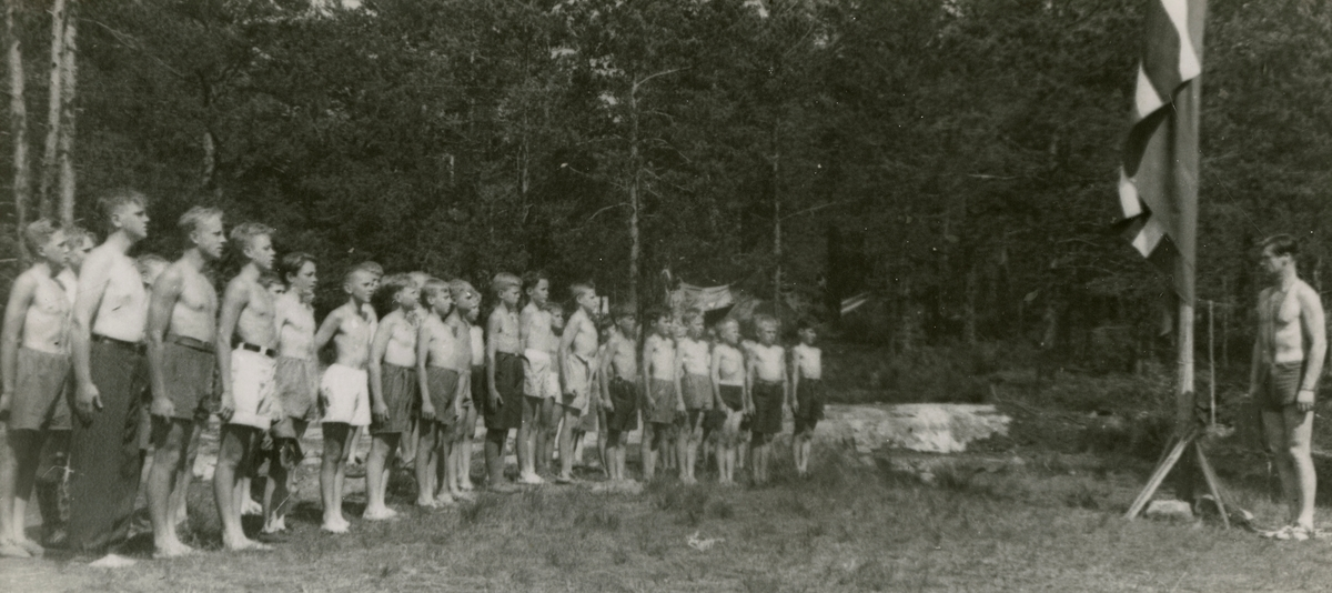 Saluting the flag, camp for boys first year of occupation