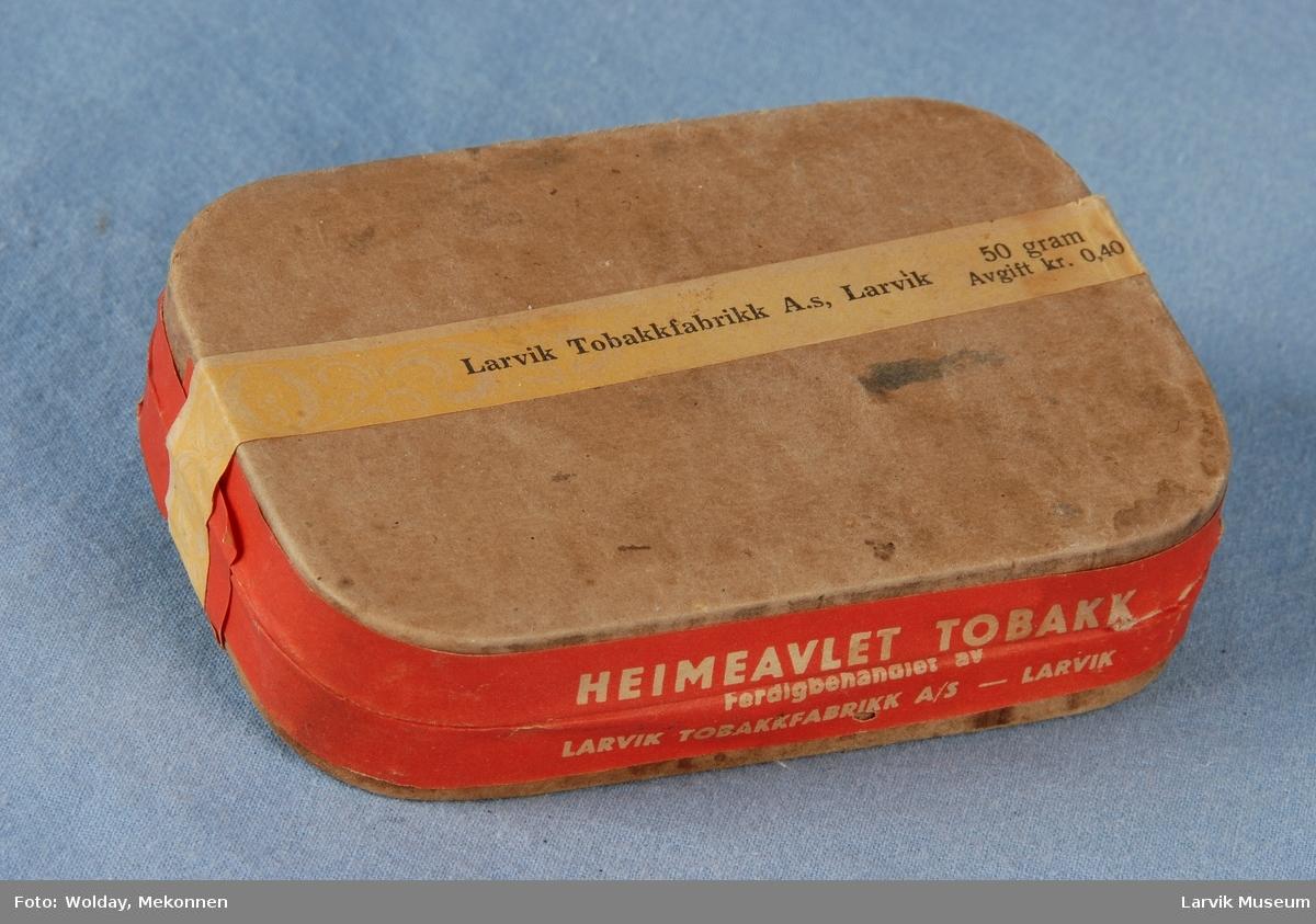 Heimeavlet tobakk i eske.