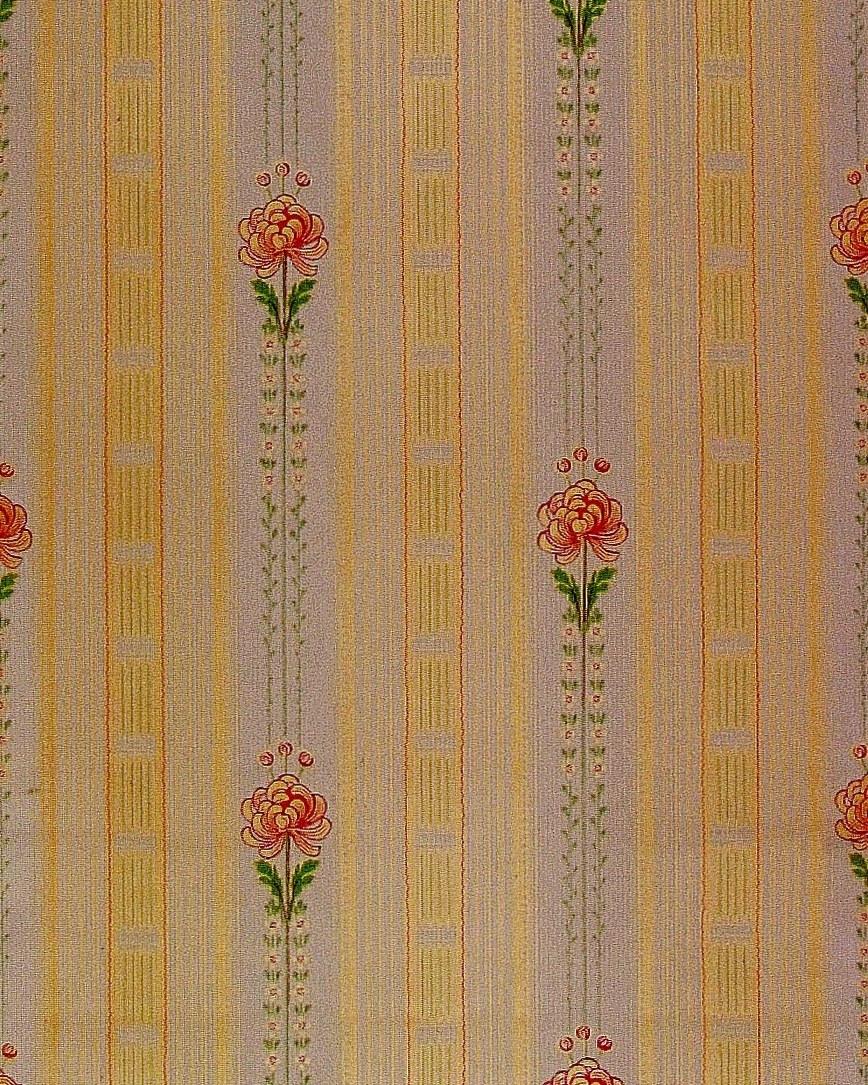 Vertikalt randmönster med en stiliserad blomma i diagonalupprepning. Tryck i ceris, gulgrönt och ljusgrått på ofärgat papper.     Tillägg historik: Tapet upphittad på vinden på Brunsta gård i Bettna. Gården är från 1850-talet.