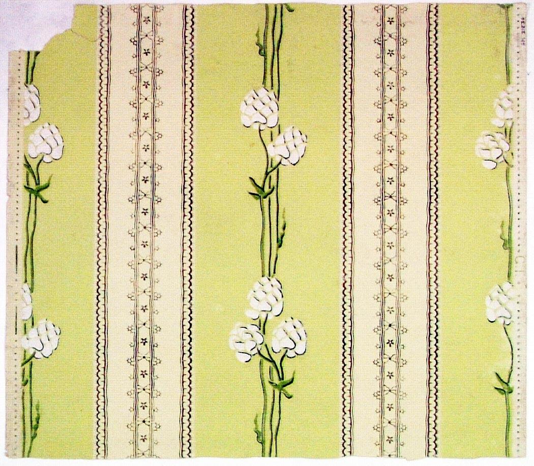 Randmönster bestående av lodräta spetsbårder omväxlande med en stiliserad jugendranka. Tryck i vitt, grönt och två ljusgrön nyanser.