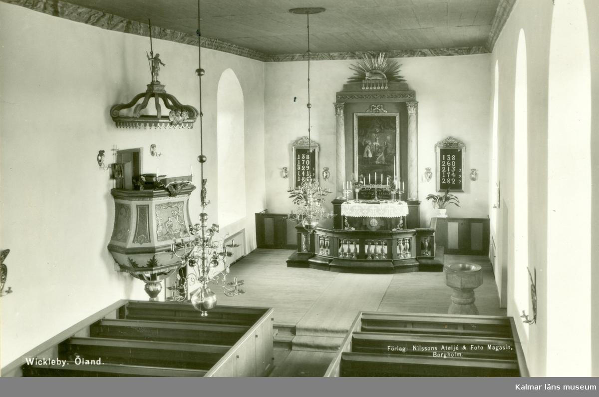 Vykort föreställande interiören i Vickleby kyrka.